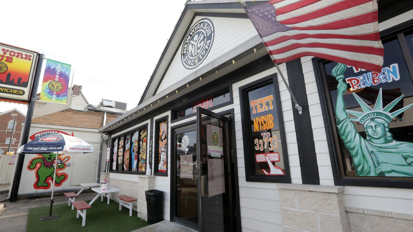 The exterior of New York Sub in Dallas features the Asbury Bear on the far left.