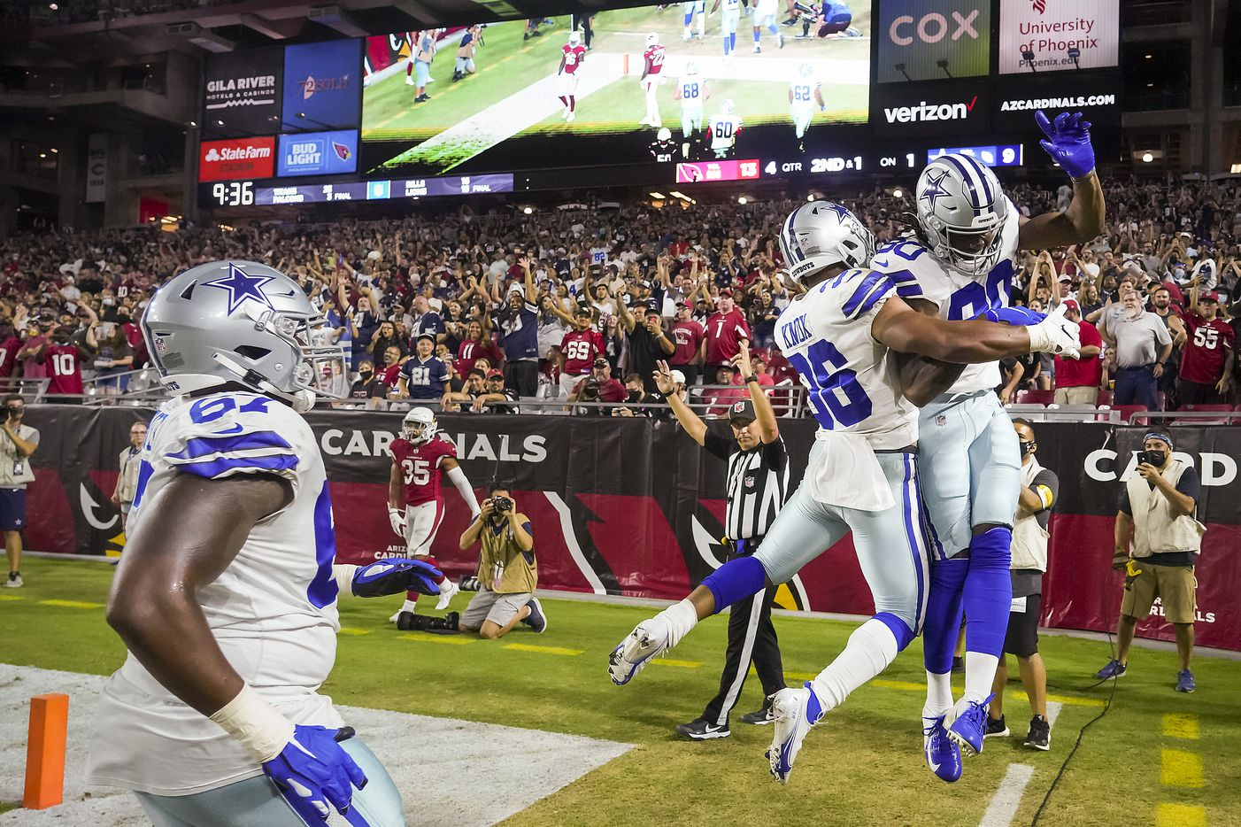 Dallas Cowboys wide receiver Brandon Smith (80) celebrates with running back Brenden Knox (36) after catching a 1-yard touchdown pass from quarterback Ben DiNucci during the second half of a preseason NFL football game against the Arizona Cardinals at State Farm Stadium on Friday, Aug. 13, 2021, in Glendale, Ariz.