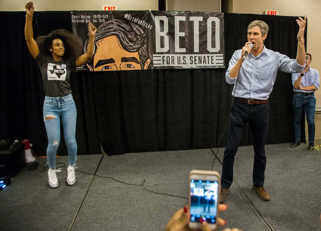 """Singer Kelly Rowland, left, dances next to Senate candidate Beto O'Rourke as a crowd shouts """"Beto"""" during a rally at Magnolia Park Cities Hotel in Dallas on Nov. 5, 2018. (Carly Geraci/The Dallas Morning News)"""
