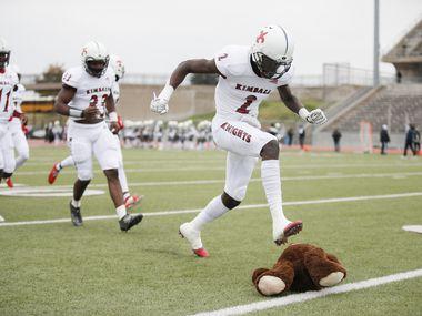 Kimball junior wide receiver Kyron Henderson (2) stomps on a stuffed bear, South Oak Cliff's mascot, before the first half of a high school playoff football game against South Oak Cliff at Kincaide Stadium in Dallas, Saturday, November 28, 2020. (Brandon Wade/Special Contributor)
