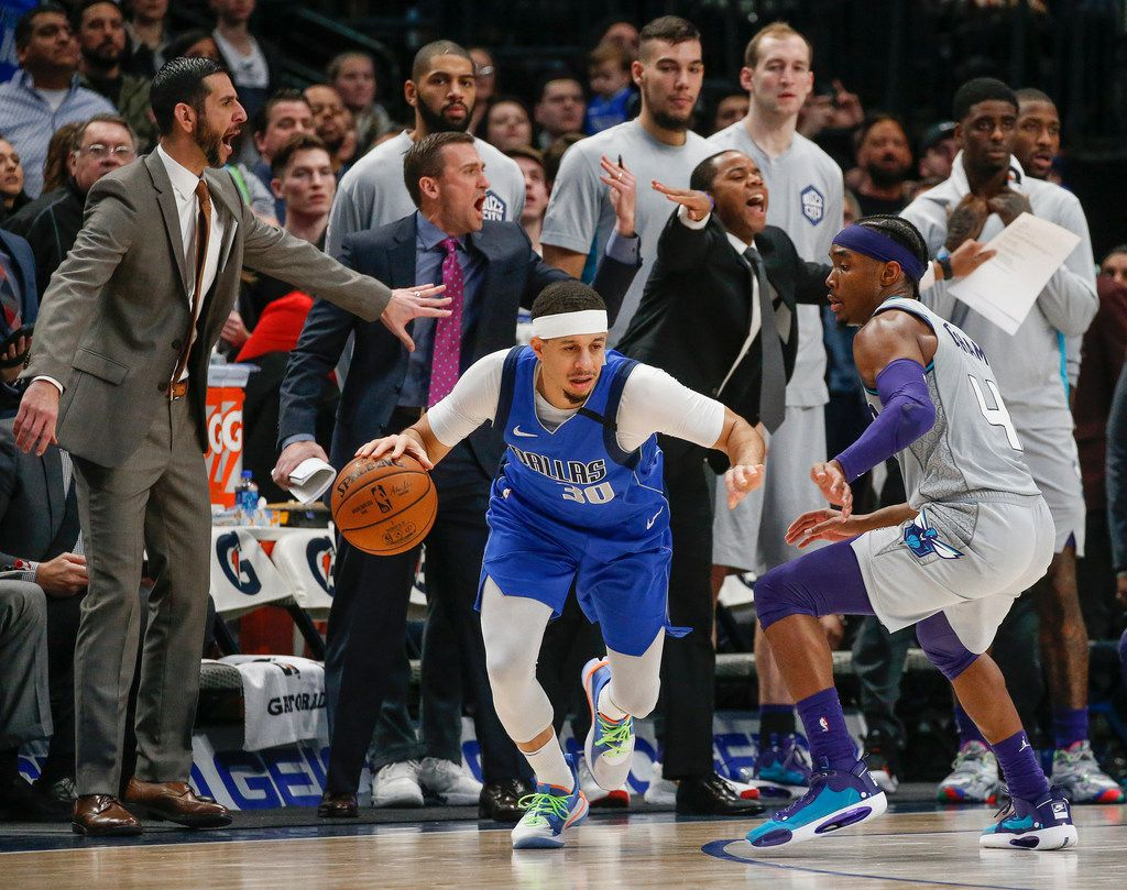 Dallas Mavericks guard Seth Curry (30) makes a break past Charlotte Hornets guard Devonte' Graham (4) during overtime in a NBA basketball game between the Dallas Mavericks and the Charlotte Hornets on Saturday, Jan. 4, 2019 at American Airlines Center in Dallas.