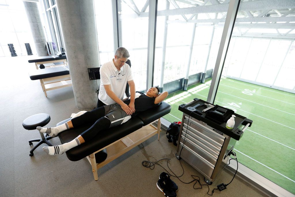 Michael Oviedo, director of performance health, works on Xining He, a basketball player from China at the Baylor Scott & White Sports Therapy & Research at The Star in Frisco on Monday, June 18, 2018.