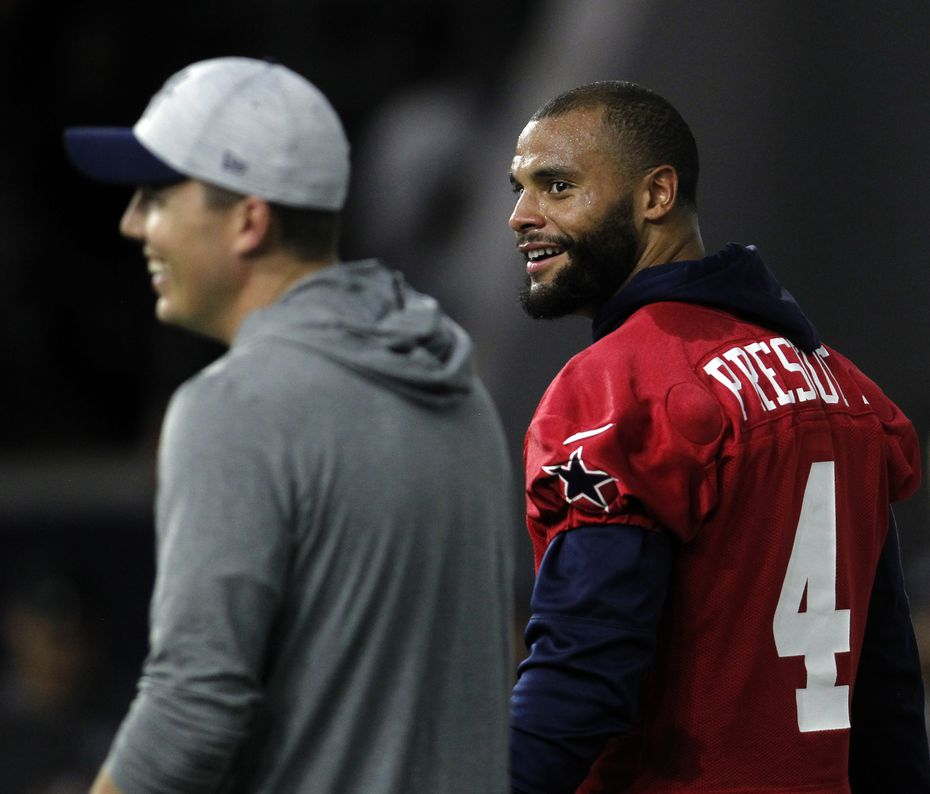 Dallas Cowboys quarterback Dak Prescott (4) shares a light moment with offensive coordinator Kellen Moore. The Cowboys conducted their final public football practice session inside The Star at the Ford Center in Frisco on August 28, 2021. (Steve Hamm/ Special Contributor)