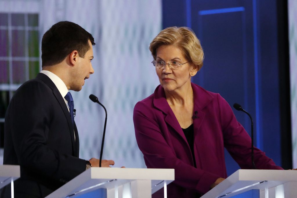 Democratic presidential candidate South Bend, Ind., Mayor Pete Buttigieg speaks with Sen. Elizabeth Warren, D-Mass., during a commercial break in a Democratic presidential primary debate, Wednesday, Nov. 20, 2019, in Atlanta. (AP Photo/John Bazemore)