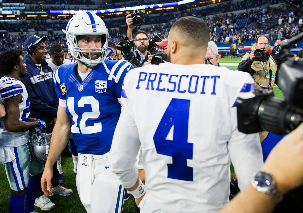 Dallas Cowboys quarterback Dak Prescott (4) greets Indianapolis Colts quarterback Andrew Luck (12) after an NFL game between the Dallas Cowboys and the Indianapolis Colts on Sunday, December 16, 2018 at Lucas Oil Stadium in Indianapolis, Indiana. Dallas Cowboys lost 23-0. (Ashley Landis/The Dallas Morning News)
