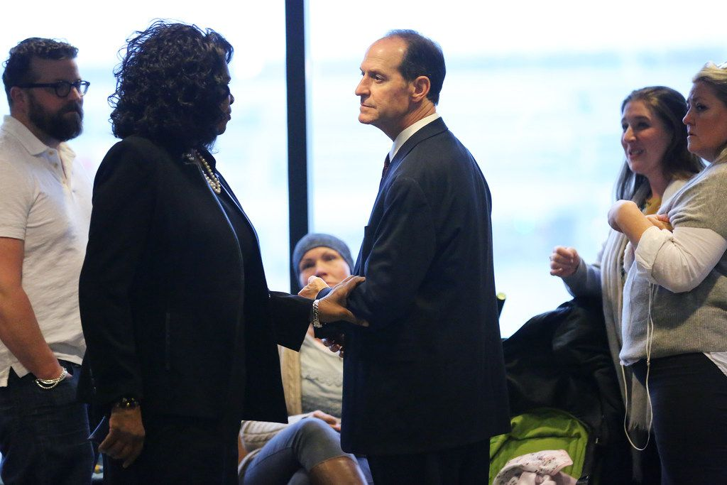District Attorney Faith Johnson (second from left) spoke with lead prosecutor Pat Kirlin and the family of Zoe Hastings while the jury deliberated.
