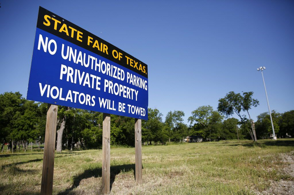 A no-parking sign on vacant land along Bank Street owned by the State Fair of Texas near Fair Park