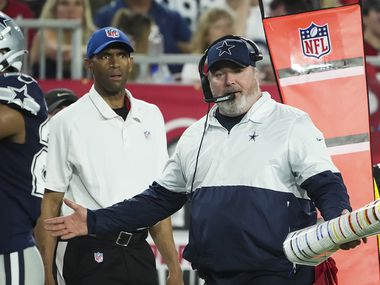 Dallas Cowboys head coach Mike McCarthy argues a call during the first half of an NFL football game against the Tampa Bay Buccaneers at Raymond James Stadium on Thursday, Sept. 9, 2021, in Tampa, Fla.