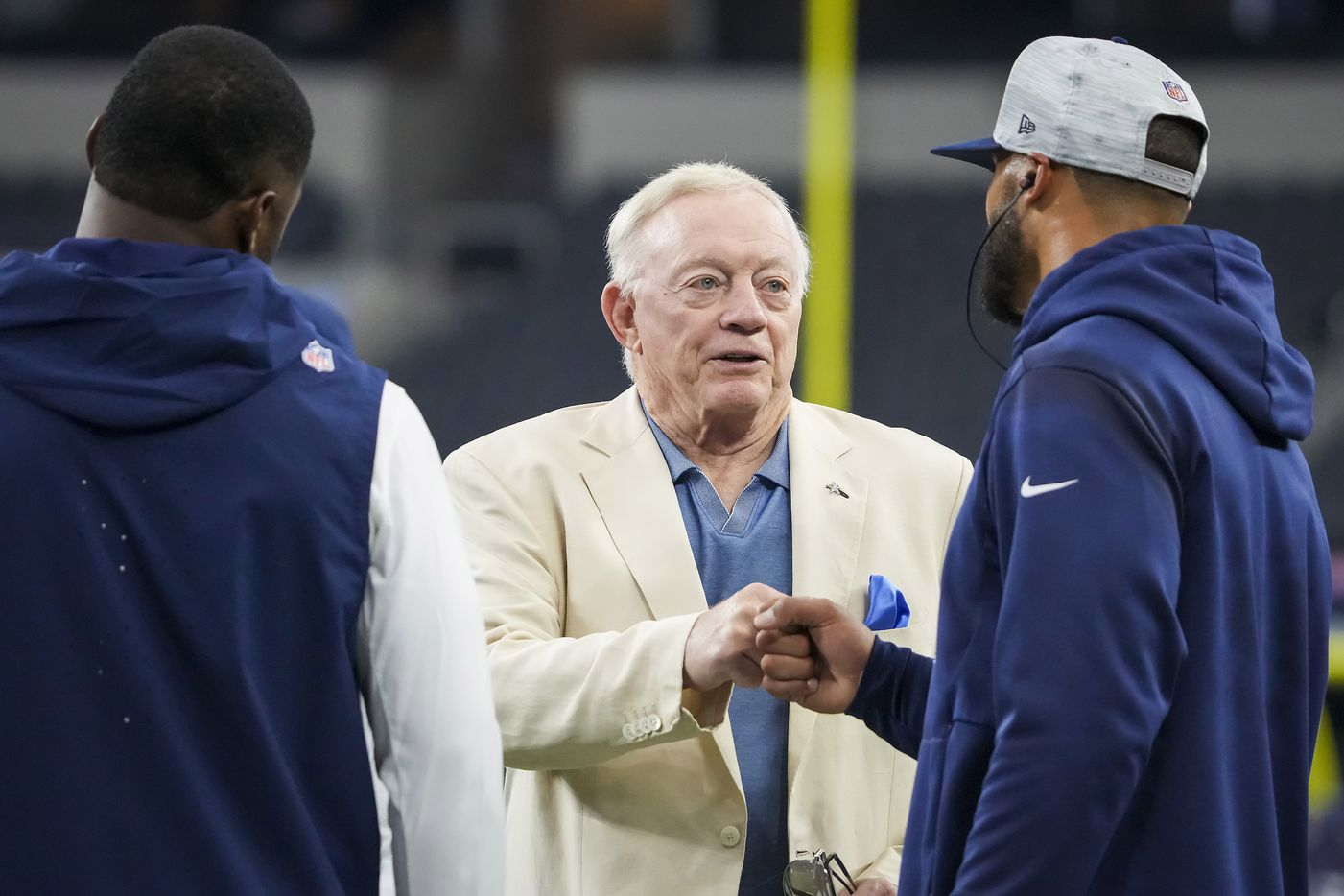 Dallas Cowboys owner and general manager Jerry Jones fist bumps quarterback Dak Prescott as he chats with wide receiver Amari Cooper while players warm before a preseason NFL football game at AT&T Stadium on Sunday, Aug. 29, 2021, in Arlington. (Smiley N. Pool/The Dallas Morning News)