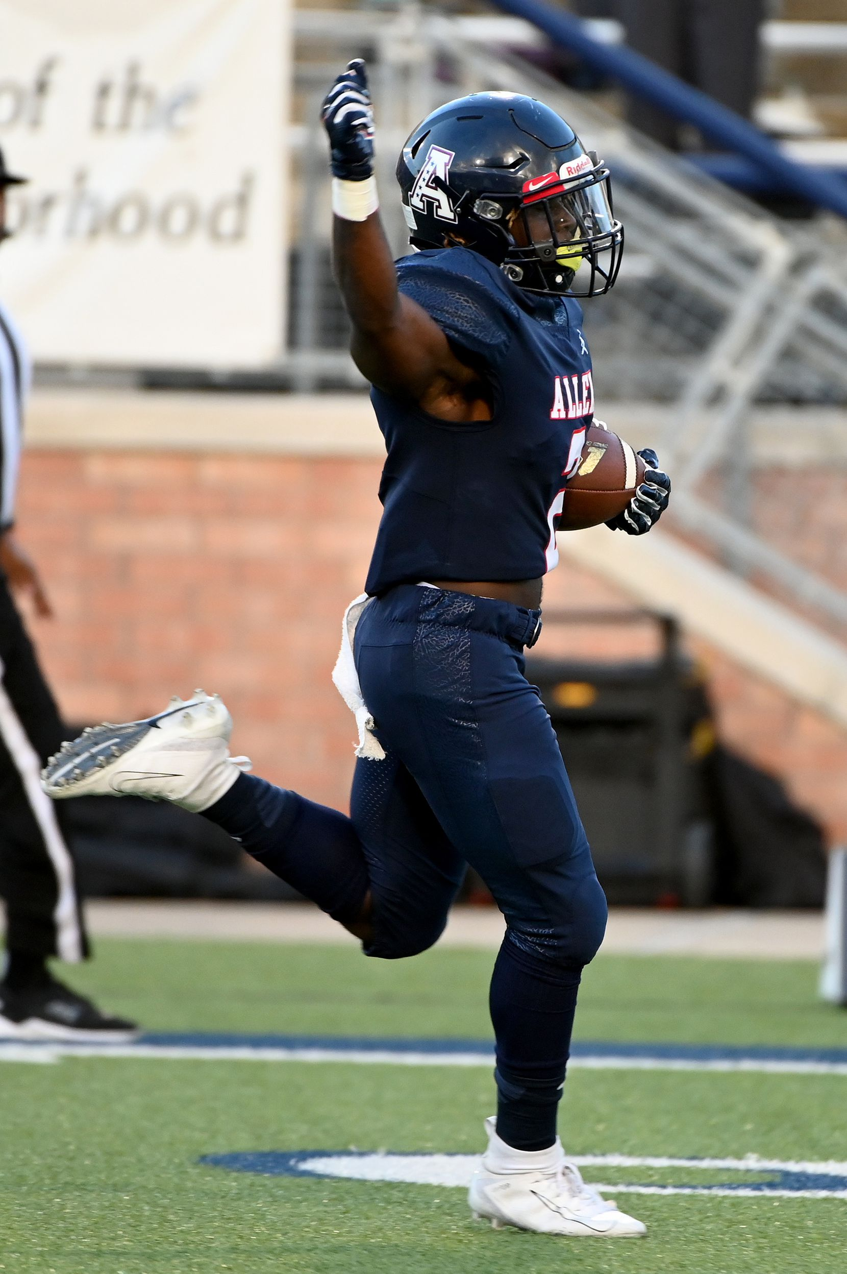 Allen's Jaylen Jenkins celebrate as he runs the opening kickoff of the 2021 season back for a touchdown in the first half during a high school football game between Plano East and Allen, Friday, Aug. 27, 2021, in Allen, Texas. (Matt Strasen/Special Contributor)