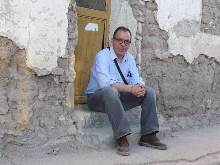 In this 2007 photograph, Alfredo Corchado sits outside his grandmother's home, where he was born in Durango state.