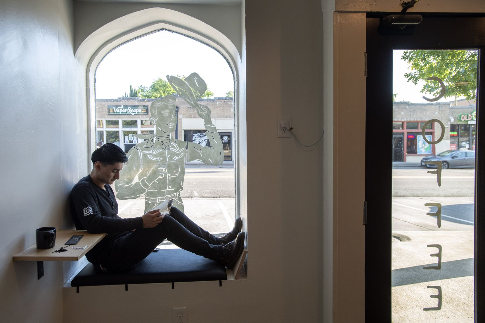 Best seat in the house? Ever Escobar, 20, finds a quiet spot to read at Wayward Coffee in Oak Cliff.