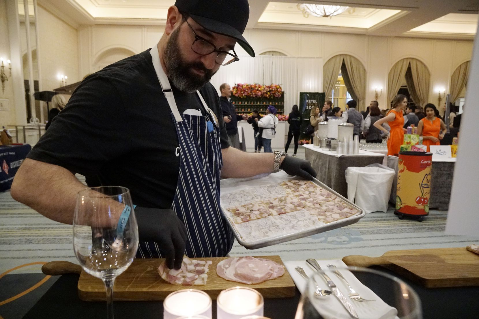Chef David Uygur adds head cheese to a plate in preparation for the judging at Cochon555 Tour at the Four Seasons Hotel in Irving.