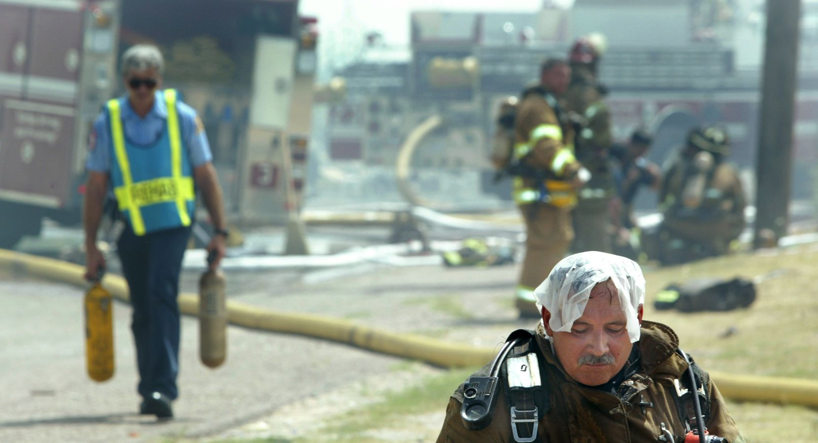 In this 2003 file photo, Michael Dorety took a break while battling a fire in Dallas. He retired from the department in 2010 after fighting fires for 39 years.