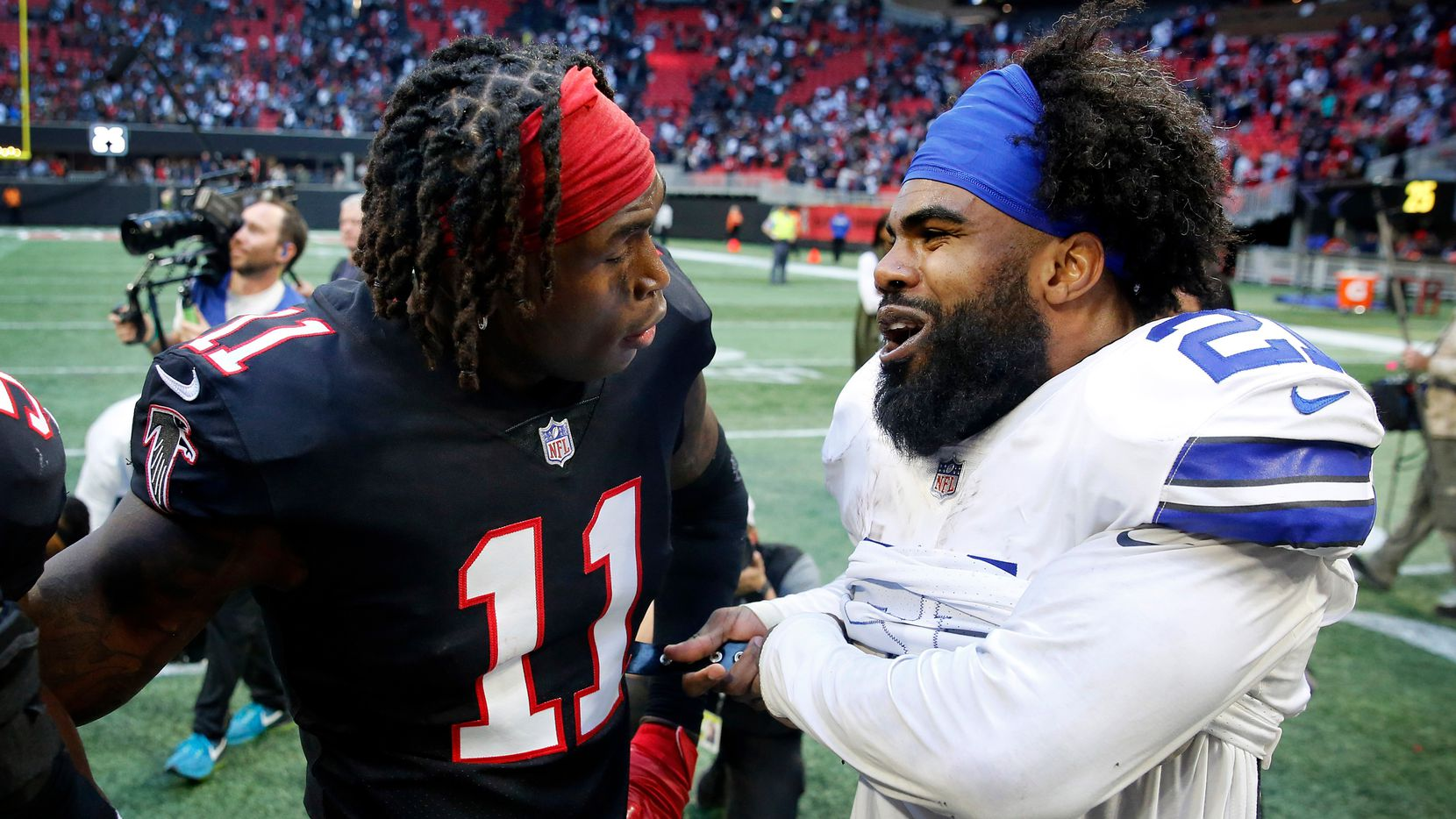 Dallas Cowboys running back Ezekiel Elliott (21) and Atlanta Falcons wide receiver Julio Jones (11) visit after the game at Mercedes-Benz Stadium in Atlanta, Sunday, November 18, 2018. The Cowboys pulled out a 22-19 win.