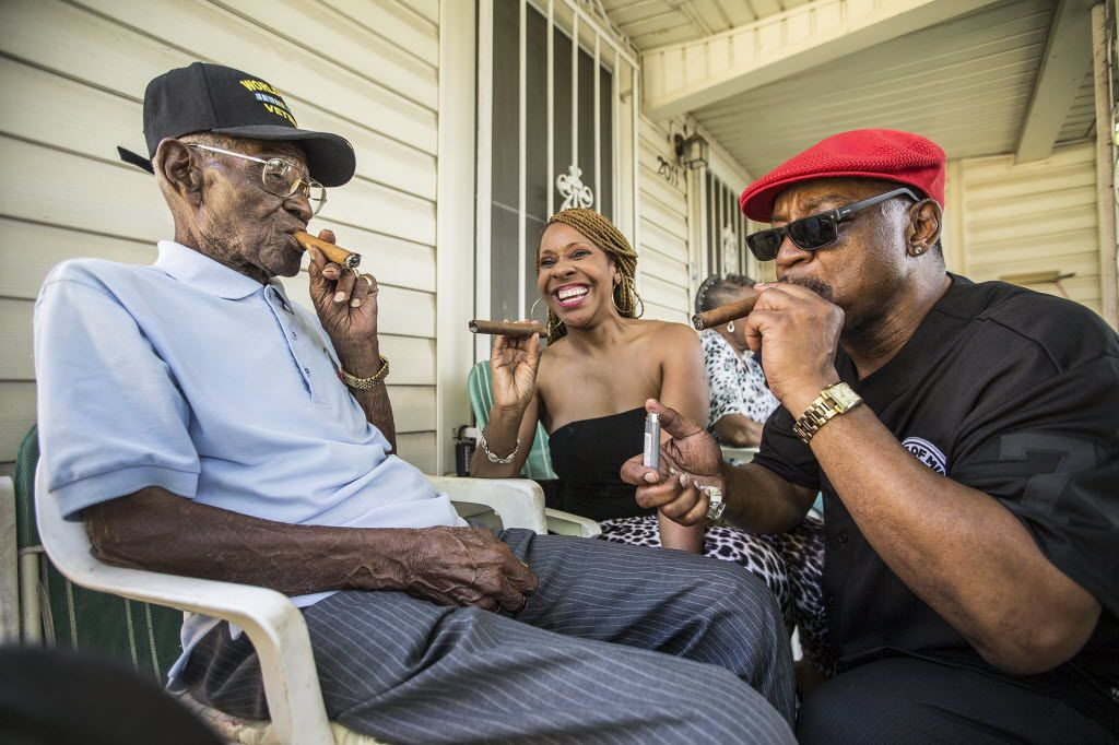 Richard Overton, left, smokes a cigar wit friends Donna Shorts, center and Martin Wilford in May 2015.