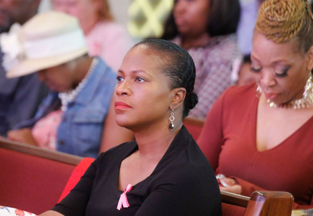 Jacqueline Byrd listens to her husband, Pastor Andre Byrd Sr., preach at the New Covenant Christian Fellowship Church during Sunday service Oct. 15, 2017. She will accompany her husband and the church's choir to Spain later this month.