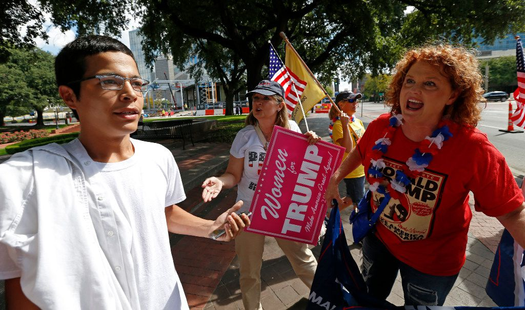 Trump supporter Kimberly Loyd of McKinney (right) argued with Anthony Saenz of Dallas, a Hillary Clinton supporter, across from The Dallas Morning News on Wednesday.