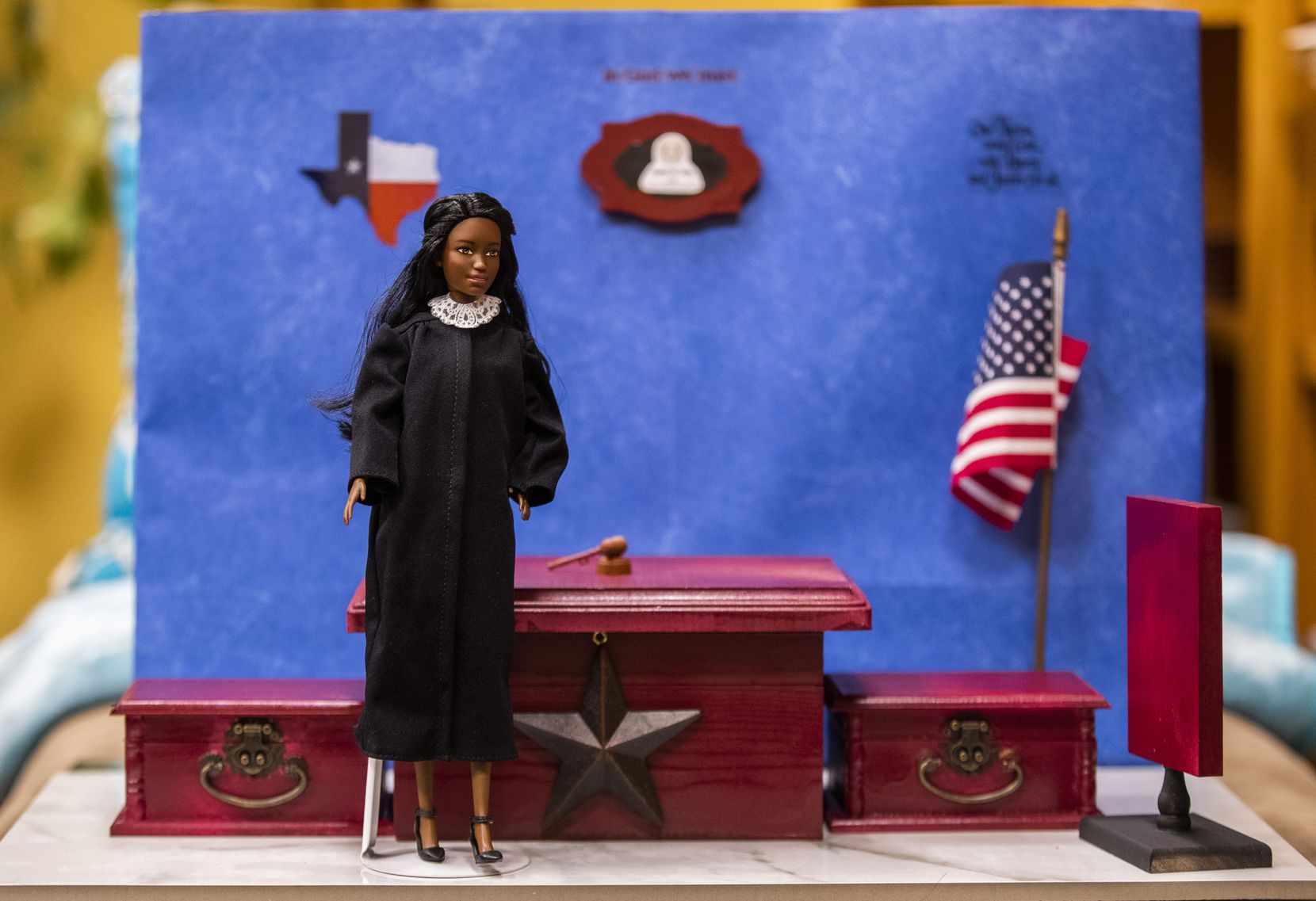 "A Judge Barbie doll stands in a model courtroom created by Dallas County Criminal Court Judge Angela King on Monday, November 11, 2019, at Frank Crowley Courts Building in Dallas. ""I grew up in the era of 'girls don't do that. Boys do that,' "" said King. ""I was always: 'Don't tell me girls can't do that. I'll show you we can and we can do it better.' "" (Ashley Landis/The Dallas Morning News)"