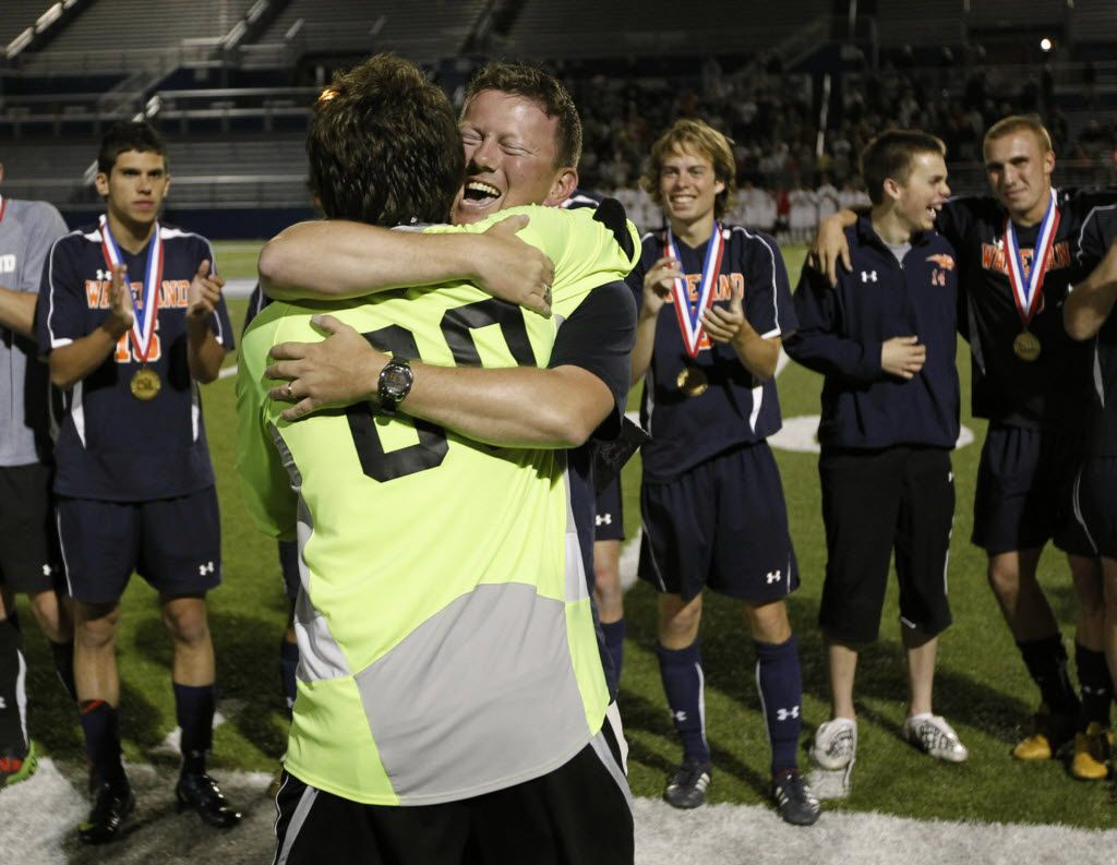Goalkeeper Nick Petolick and coach Rusty Oglesby hug after Frisco Wakeland defeated Humble Kingwood Park in a shootout to win the Class 4A state championship in 2010.