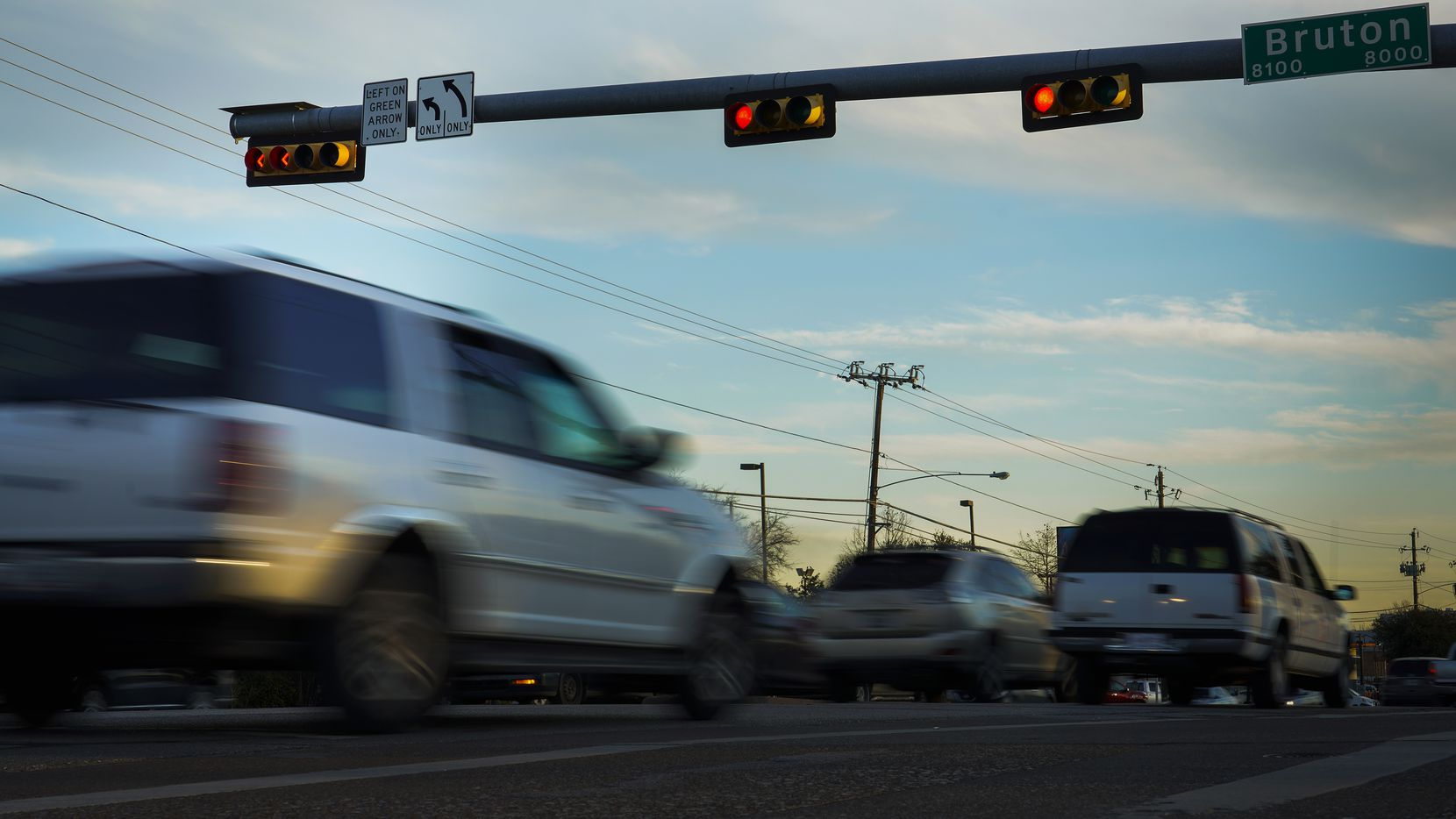 Cars run a red light at  South Buckner Boulevard and Bruton Road on Friday, Feb. 7, 2020, in Dallas. Traffic accidents quadrupled at the intersection after Texas banned red light cameras.