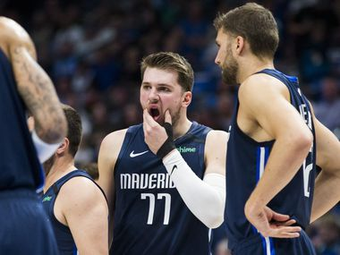 Dallas Mavericks guard Luka Doncic (77) reacts after being hit in the face by the knee of Indiana Pacers guard Edmond Sumner (5) during the second quarter of an NBA game between the Indiana Pacers and the Dallas Mavericks on Sunday, March 8, 2020 at American Airlines Center in Dallas.