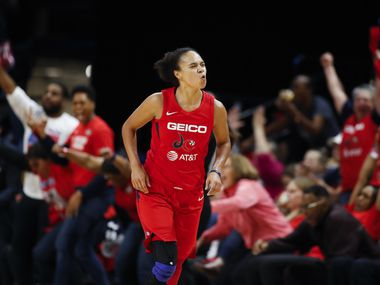 Former Washington Mystics, current LA Sparks guard Kristi Toliver celebrates after her three-point basket during the first half of Game 5 of basketball's WNBA Finals against the Connecticut Sun, Thursday, Oct. 10, 2019, in Washington.