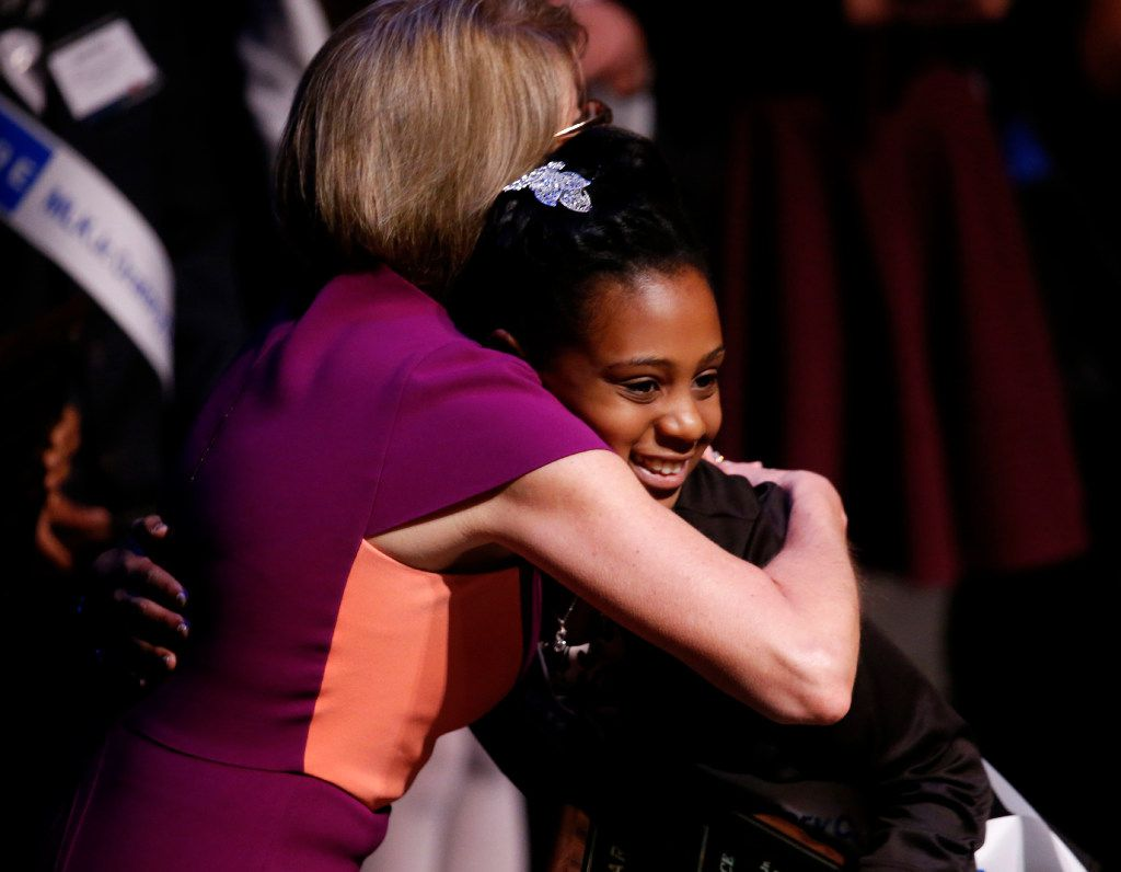 Sierra Jones, a fifth grader at Charles Rice Learning Center, gets a hug from Holland N. O'Neil, chair of the Gardere Wynne Sewell LLP, after winning first place during the 25th Annual Gardere MLK Jr. Oratory Competition at the Majestic Theatre in Dallas on Friday, Jan. 13, 2017. (Rose Baca/The Dallas Morning News)
