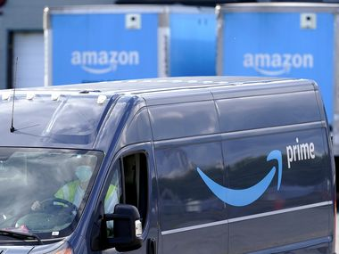 An Amazon Prime logo appears on the side of a delivery van as it departs an Amazon Warehouse location, Thursday, Oct. 1, 2020, in Dedham, Mass. (AP Photo/Steven Senne)
