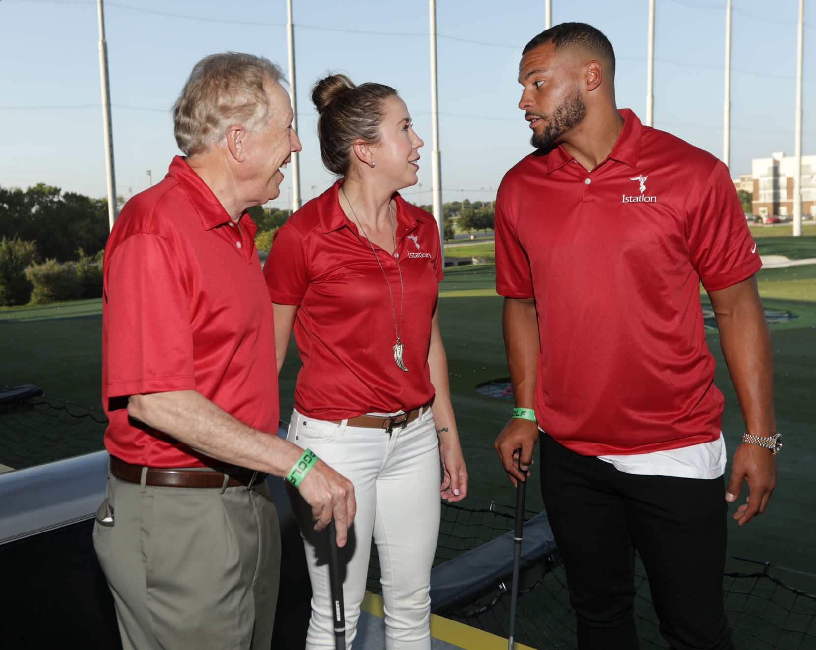 Richard Collins, left, Genevieve Collins, and Dak Prescott talk during the Tackle Tomorrow Today charity golf tournament opening dinner at Top Golf in The Colony on Aug. 27, 2018. (Jason Janik/Special Contributor)