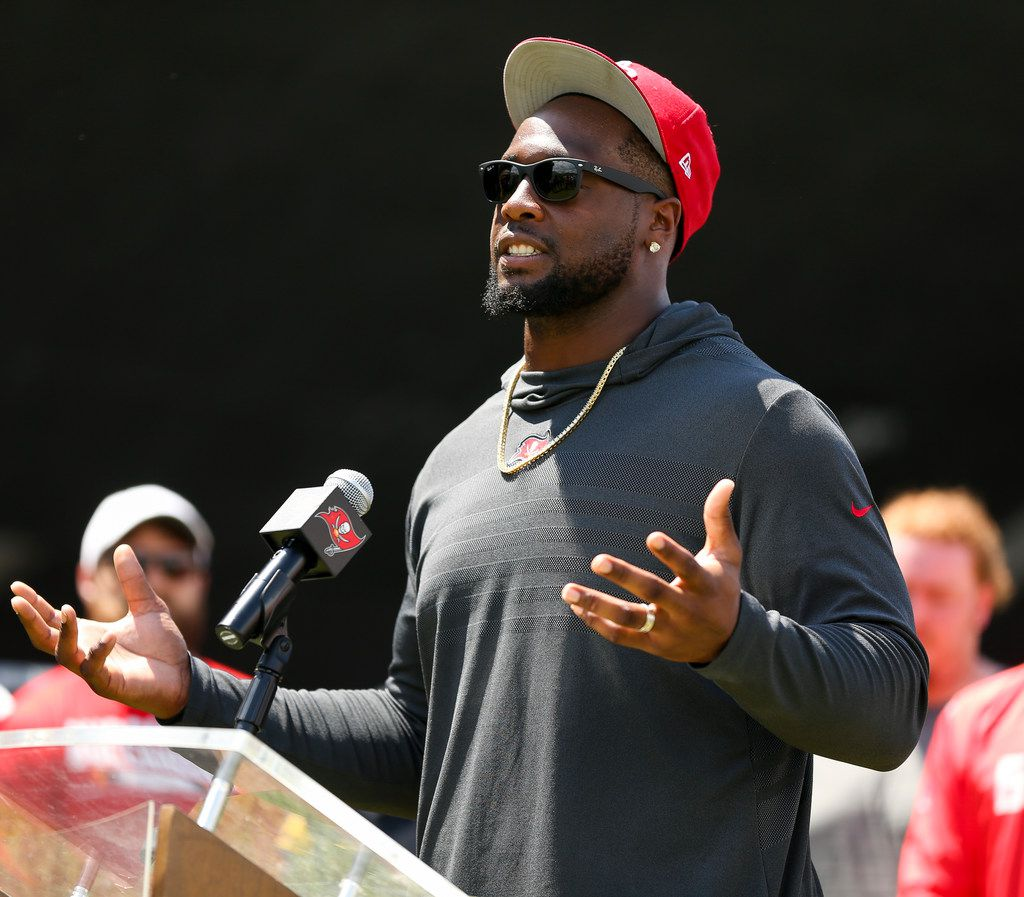 FILE - In this Sept. 18, 2018, gilr photo, Tampa Bay Buccaneers' Gerald McCoy speaks during an announcement of the NFL football team's social justice initiative at the Tampa Police Department Training Academy in Tampa, Fla. The Buccaneers are moving on from Gerald McCoy. The team released the six-time Pro Bowl defensive tackle, describing the move as a mutual agreement after nine seasons. (Monica Herndon/Tampa Bay Times via AP, File)
