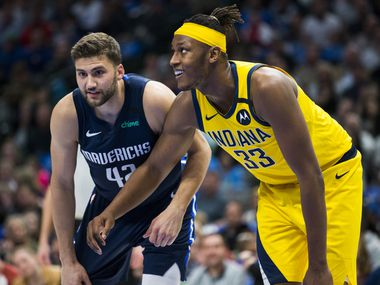 Dallas Mavericks forward Maxi Kleber (42) and Indiana Pacers center Myles Turner (33) looks for a rebound during the second quarter of an NBA game between the Indiana Pacers and the Dallas Mavericks on Sunday, March 8, 2020 at American Airlines Center in Dallas.