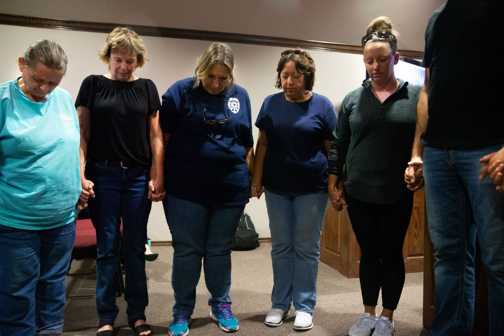 Community members met for prayer before the City Council meeting in Ferris on Oct. 7, 2019. The meeting included an agenda item to determine if the resignation of Police Chief Eddie Salazar would be accepted, and many came out to show support for Salazar. (Lynda M. Gonzalez/The Dallas Morning News)