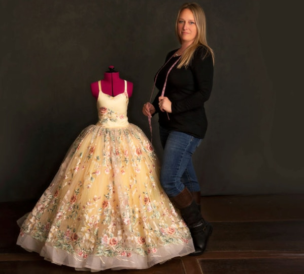 Bee J Stanley of Keller shows one of her dress designs. Stanley is the owner of Blutterfly Baby Boutique. (Courtesy: Jennifer Braly)