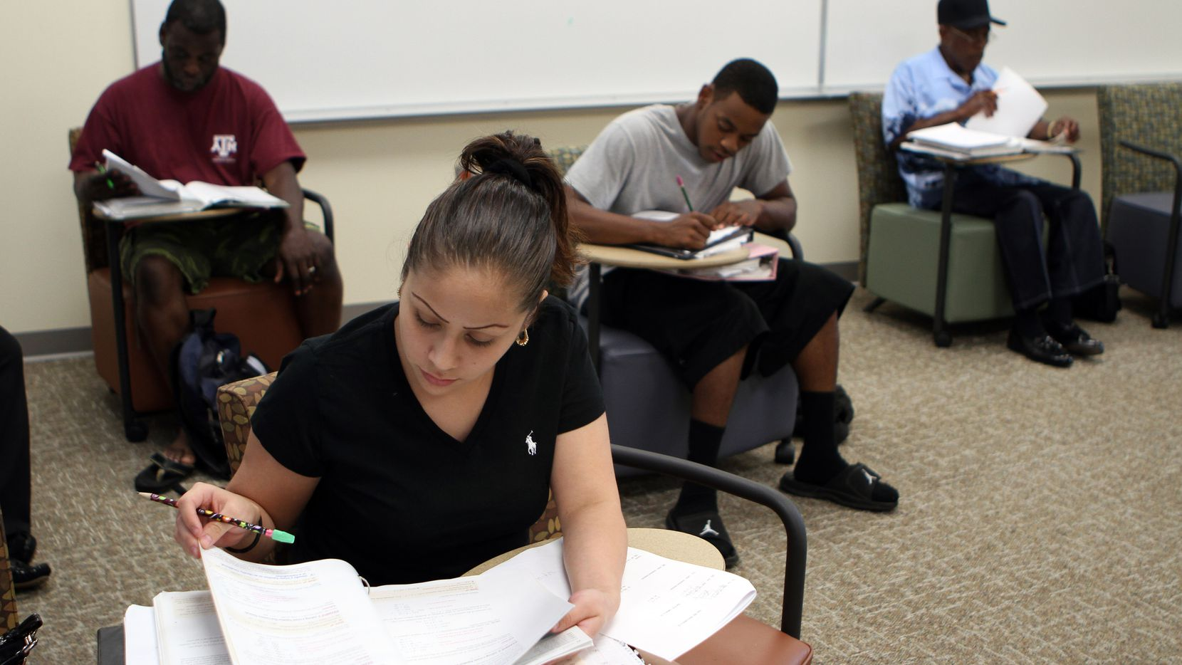 Grecia Gonzales, 22, of Dallas, works on a pre-algebra final exam at the Eastfield College Pleasant Grove campus.