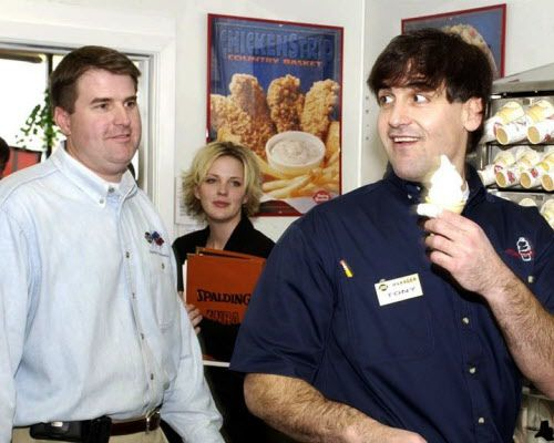 Dallas Mavericks owner Mark Cuban serves up a soft-serve cone to the approval of DQ Manager Parrish Chapman (left) and Kim Skeffington (right) during his stint behind the counter at the Coppell Dairy Queen.