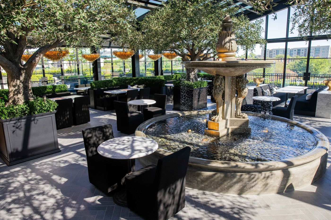 The dining area of the RH restaurant has fountains and French doors.
