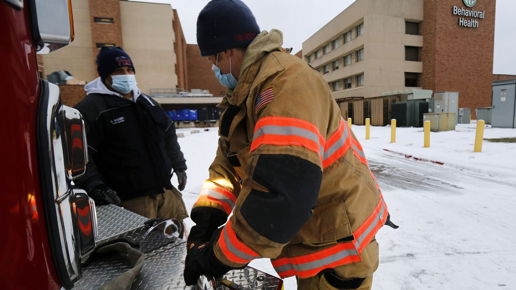 Arlington Fire Department Lt. Josh Jones hooks up a new water hose to Engine 4 in Arlington, Wednesday, February 17, 2021 to help add water pressure within Arlington Memorial Hospital.