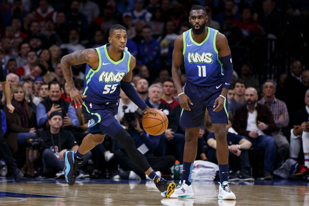 Dallas Mavericks' Delon Wright, left, in action with Tim Hardaway Jr., right, during the first half of an NBA basketball game against the Philadelphia 76ers, Friday, Dec. 20, 2019, in Philadelphia. The Mavericks won 117-98. (AP Photo/Chris Szagola)