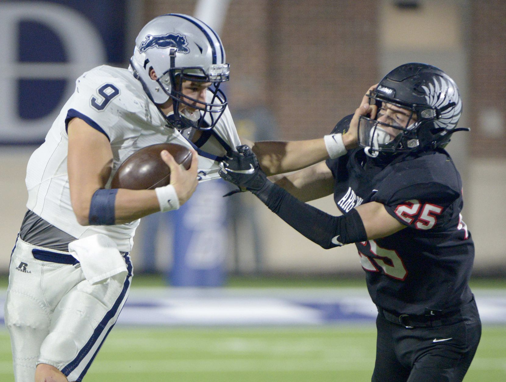 Paris' Luke Hohenberger (32) tries to fight through a tackle attempt by Argyle's Hunter Roberts (25) in the second half during a Class 4A Division I Region II final playoff football game between Paris and Argyle, Saturday, Dec. 5, 2020, in McKinney,  Texas. (Matt Strasen/Special Contributor)