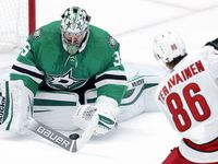Dallas Stars goaltender Anton Khudobin (35) covers a shot by Carolina Hurricanes left wing Teuvo Teravainen (86) during the first period at the American Airlines Center in Dallas, Tuesday, April 27, 2021.