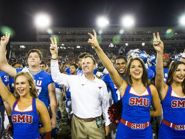 SMU head coach Chad Morris stands for the school song after the Mustangs 31-13 victory over North Texas an NCAA football game at Ford Stadium on Saturday, Sept. 12, 2015, in Dallas. The win is Morris' first as a collegiate head coach. (Smiley N. Pool/The Dallas Morning News)