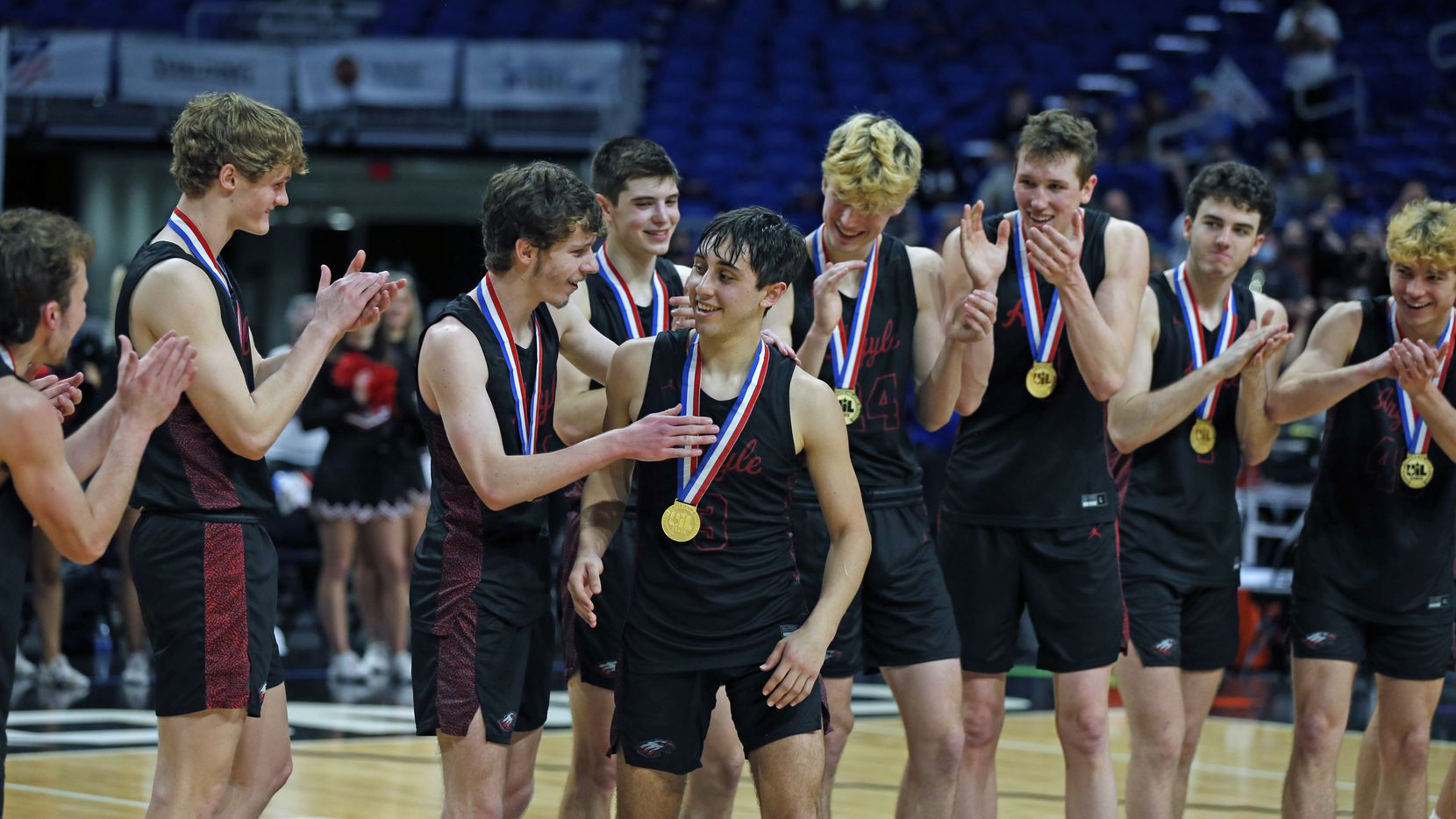 Argyle Skylar McCurry #3 is congratulated after being awarded most valuable player of the tournament. UIL boys Class 4A basketball state championship game between Argyle and Hargrave on Saturday, March 13, 2021 at the Alamodome.