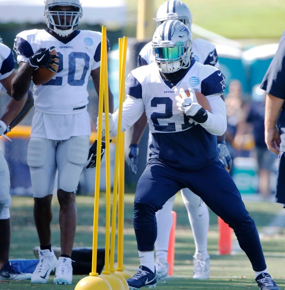 Dallas Cowboys running back Ezekiel Elliott (21) works on his footwork in a drill during training camp in Oxnard, California on Monday, August 7, 2017. (Vernon Bryant/The Dallas Morning News)
