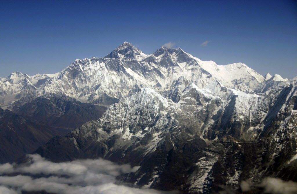Mount Everest reaches a height of just over 29,000 feet above sea level, making it the tallest mountain on Earth.