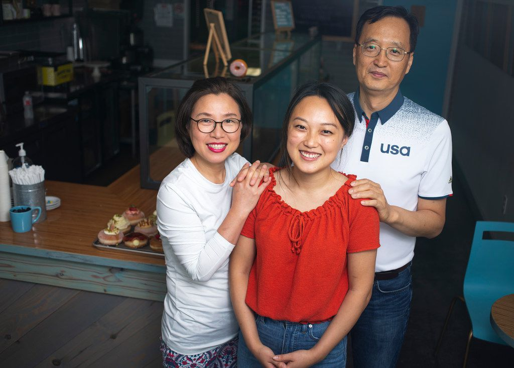 Miran Han Cho (left) and Gab Kyu Cho (right) are proud of daughter Jinny Cho, owner of Detour Doughnuts and Coffee.