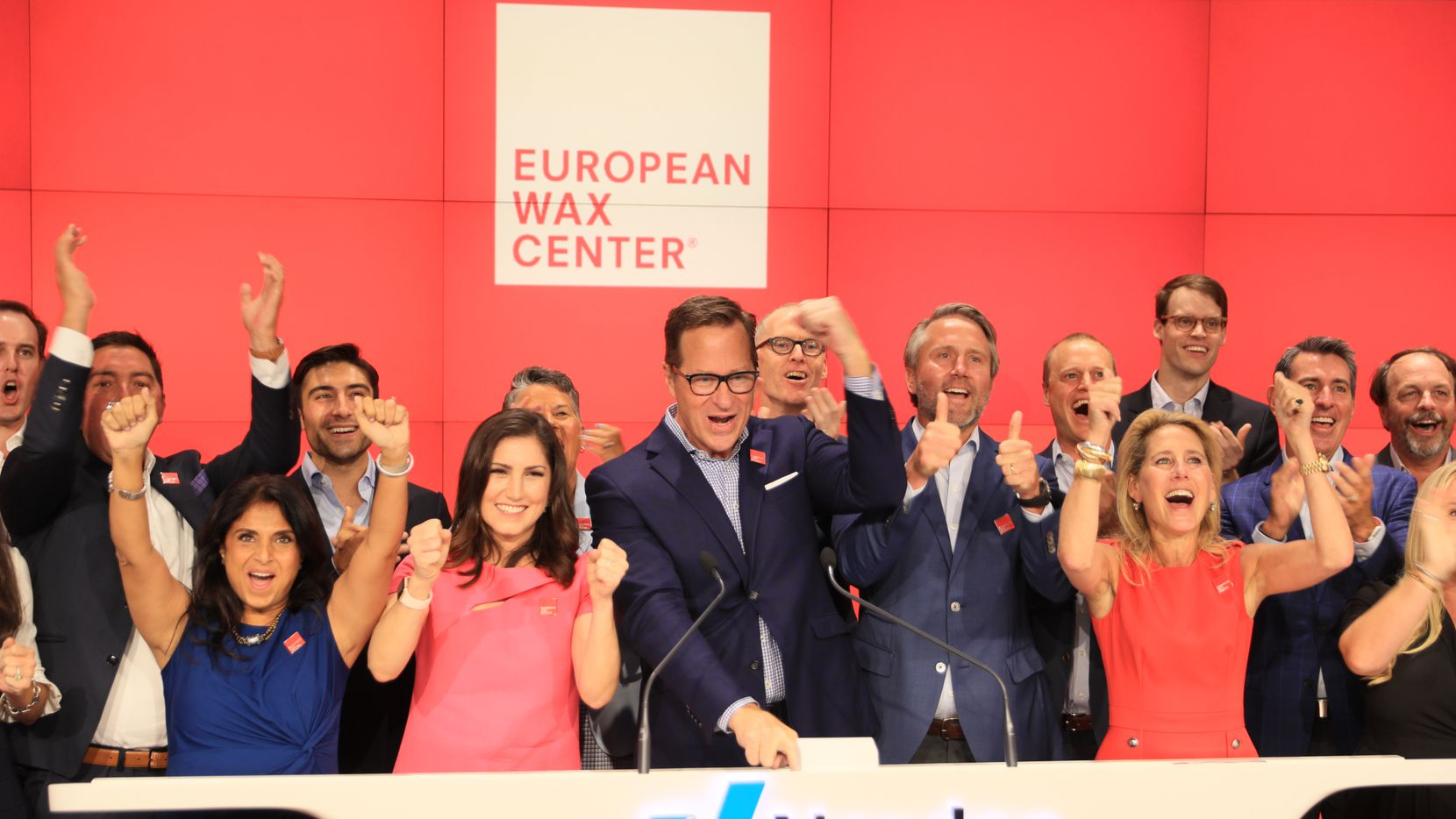 European Wax Center CEO David Berg (Center) celebrated the start of trading for EWCZ shares on the Nasdaq Thursday, Aug. 5, 2021.