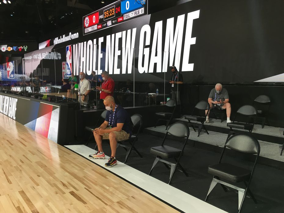 "Plexiglass protects the scorers table and the chairs in the team bench areas are spread a few feet apart at ""The Arena"" on the ESPN Wide World of Sports campus. Reporters, including Mavericks beat writer Brad Townsend, were given a preview of the facility."