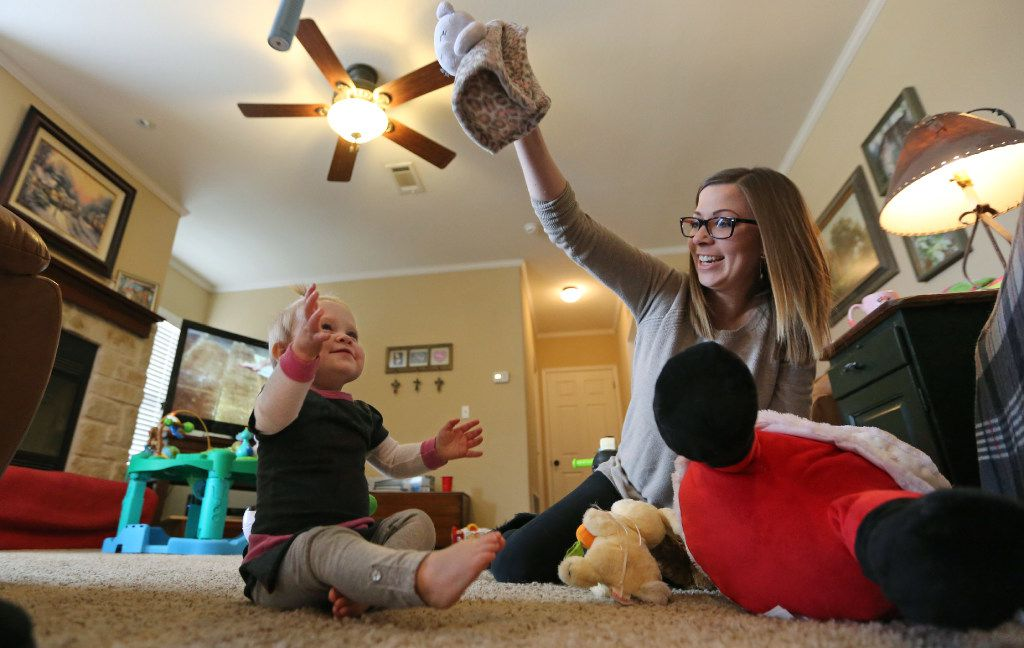Kelley McKissack, right, plays with her one-year-old daughter Kelcey, in Nevada on Thursday. She turns 1-year-old on Friday. (Louis DeLuca/The Dallas Morning News)