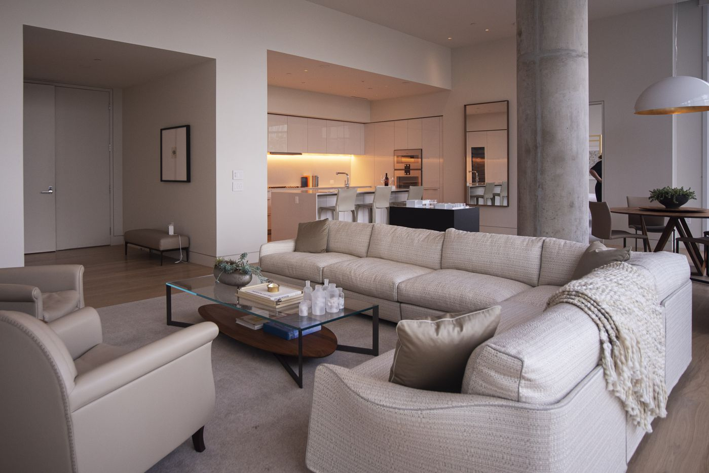 The living room area inside a model condo at the Hall Arts Residences.